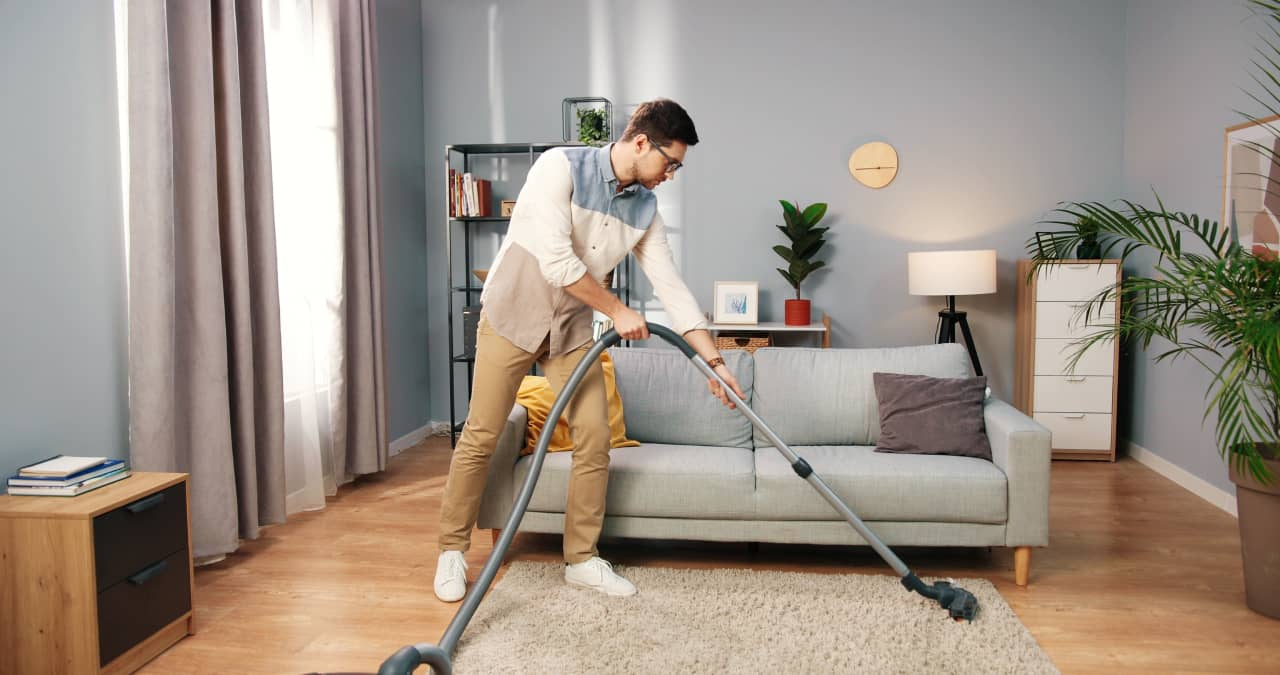 Cleaning The Carpet Weekly With Vaccum Cleaner